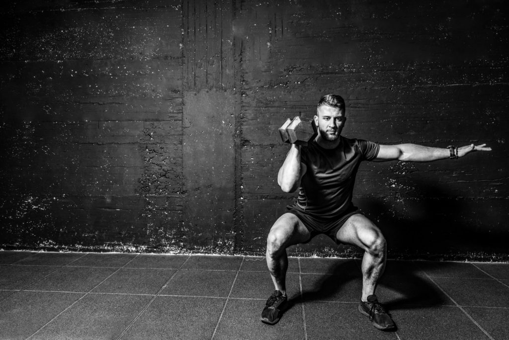 Image of a man performing shoulder exercises